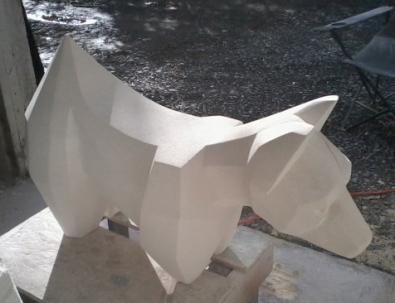 Facet Dog Oamaru Stone. 400x650x300mm SOLD